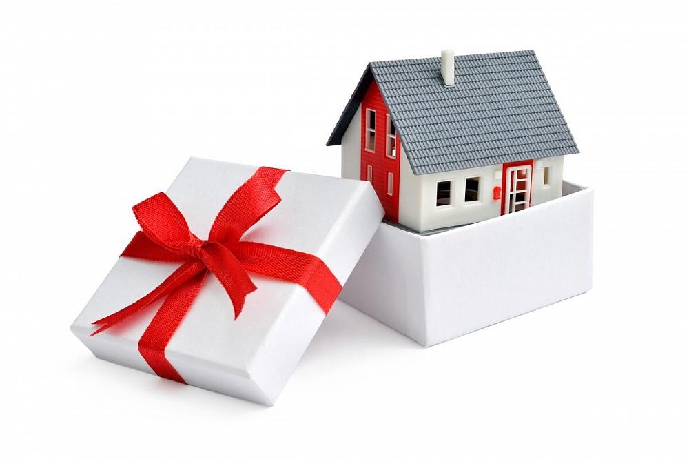 дарение недвижимости между